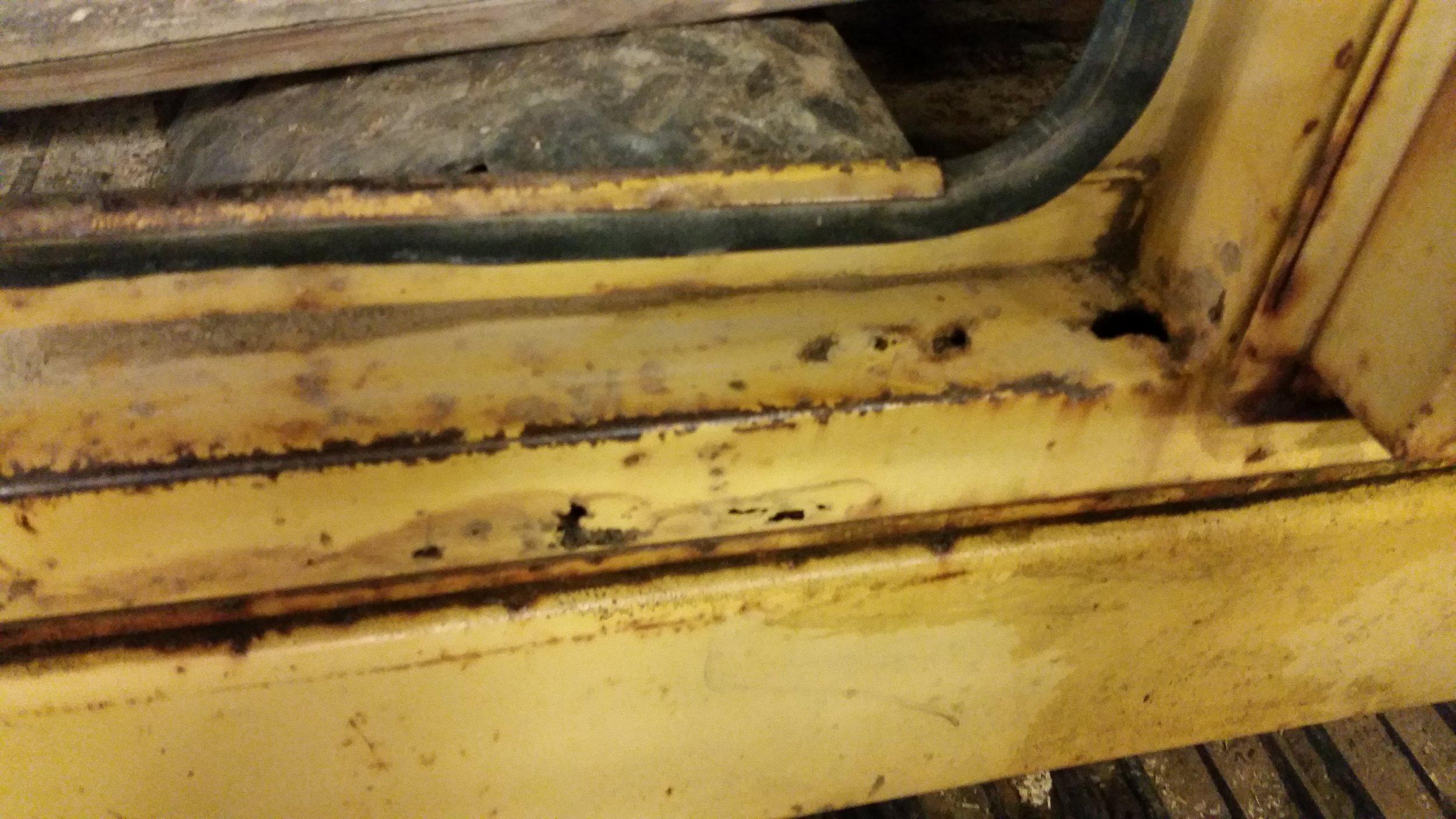 CAT Door Frame Rust.jpg