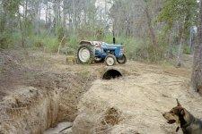 Tractor on culvert & Booger.JPG