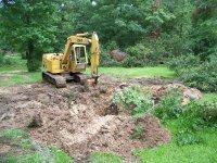 6-4-16 CAT mucking mud back into hole.jpg